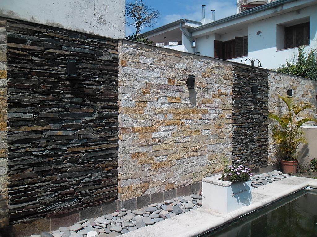 Pisan piedras naturales venta de piedras para for Paredes de patios decoradas